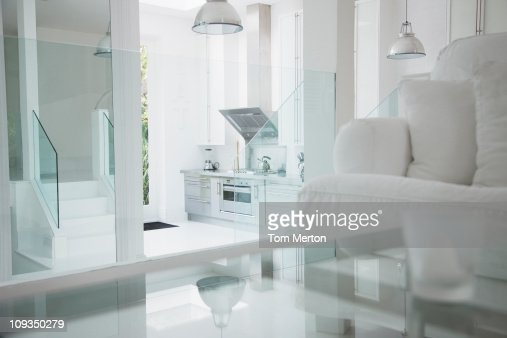 Elegant white living room and stainless steel kitchen : Stock Photo