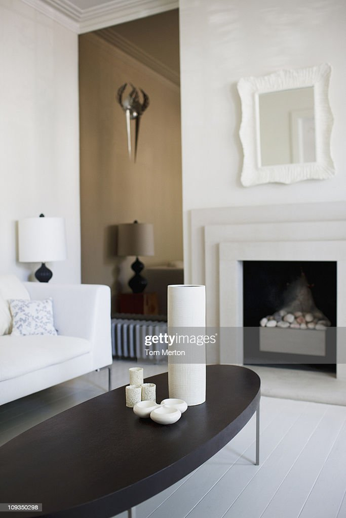 Elegant, white living room with fireplace : Stock Photo