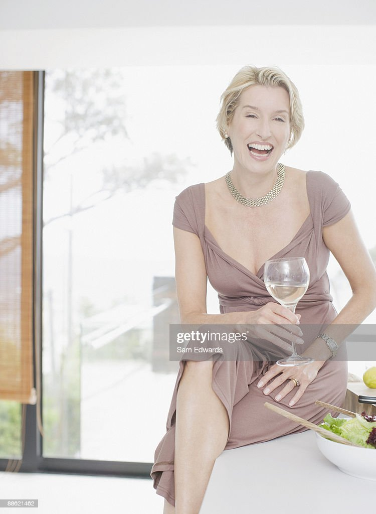 Elegant woman drinking white wine : Stock Photo