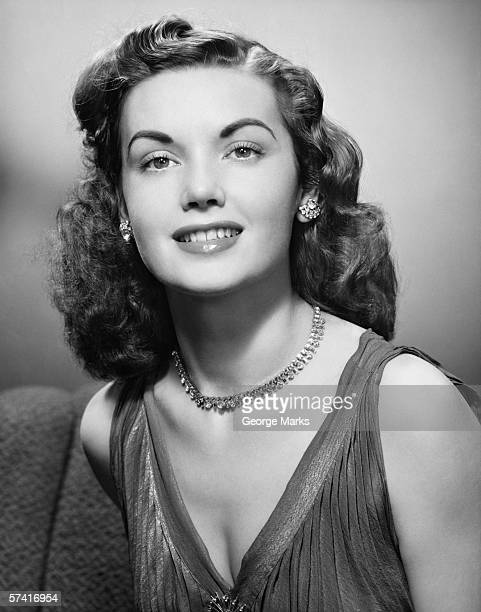 Elegant woman posing in studio, (B&W), (Close-up), (Portrait)