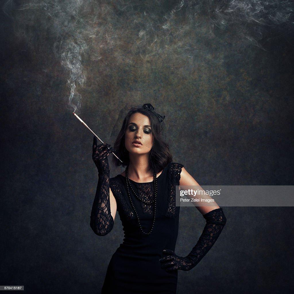 Elegant woman smoking cigarette