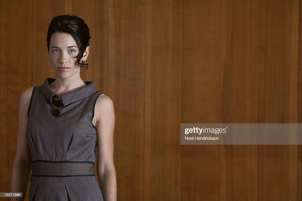 Elegant woman standing, indoors : Stock Photo
