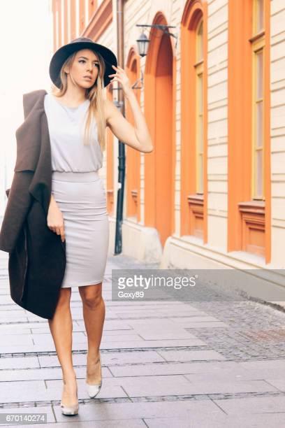 Elegant woman walking outdoors