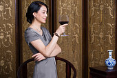 Elegant woman with red wine