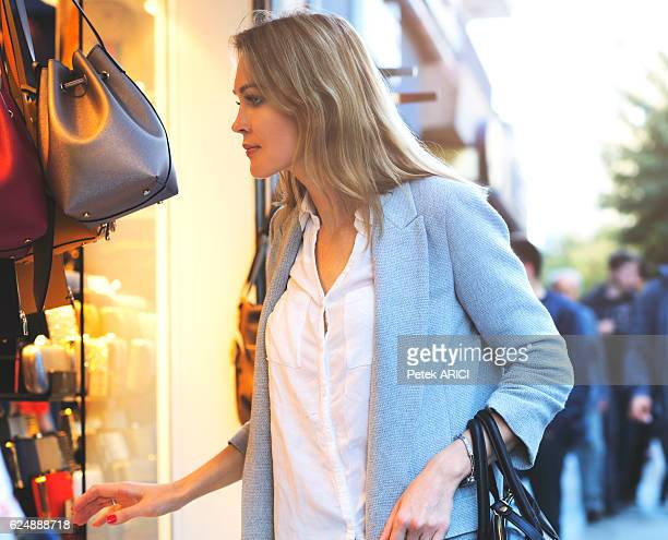 Elegant women looking through shop window