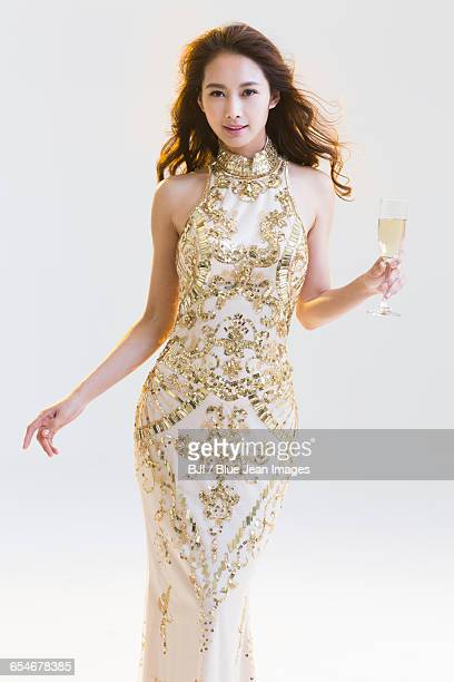 Elegant young woman drinking champagne