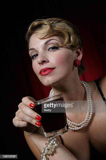 Elegant Young Woman Holding Glass