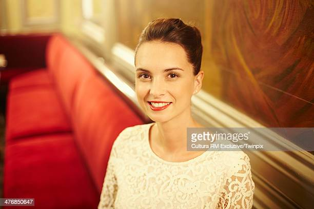 Elegant young woman in restaurant