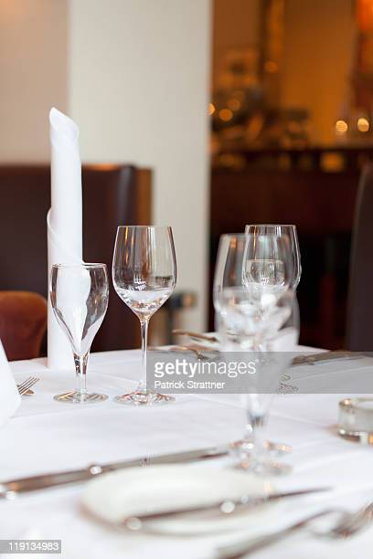 A elegantly set dining table in a restaurant