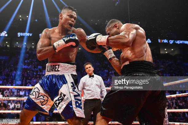 Eleider Alvarez connects with a left hook against Jean Pascal during the WBC light heavyweight silver championship match at the Bell Centre on June 3...