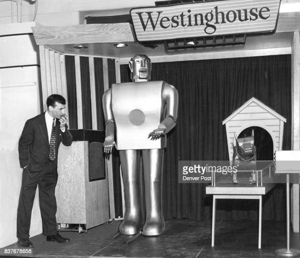 Elektro the Westinghouse mechanical man performs at the Denver Dry Goods Co under the direction of RA DuLong He can walk and obey spoken commands...