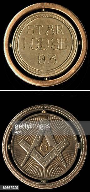 element of a pocket watch of the twentieth century which presents symbols Freemasons