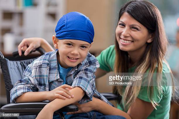 Elementary age boy in wheelchair in hospital