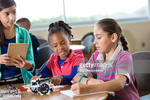 Elementary age girls building robot during robotics science class