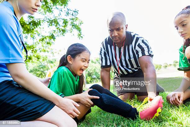 Elementary age soccer player is upset after injury