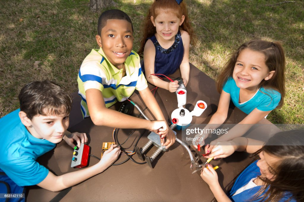 Elementary age students create robot science experiment. : Stock Photo
