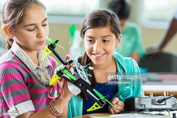 Elementary age students using drones during science technology class