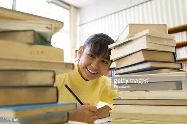 Elementary Girl Studying In The Library