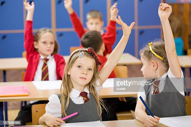 Elementary School Children Raising Hands, Front View