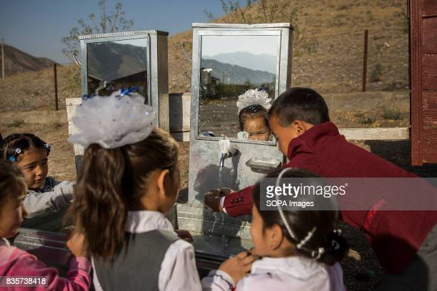 Elementary school children wash their hands before eating in the village of Lyaily near Beshkent Kyrgyzstan where nearly all 300 families use water...
