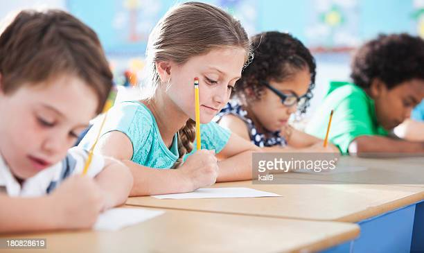 Elementary school children writing in class