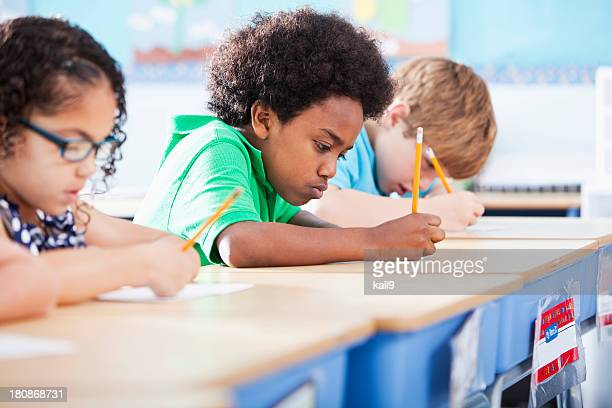 Elementary school children writing in class