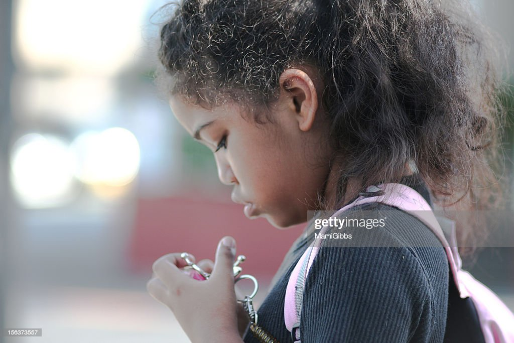 Elementary school girl look see the coin case. : Stock Photo