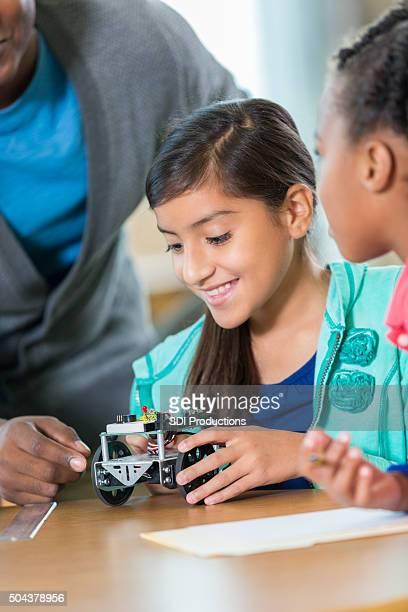 Elementary school girls building robots during after school program