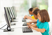 group elementary school students in computer class