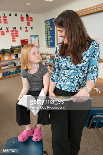 Elementary School Teacher Helping Student : Foto stock