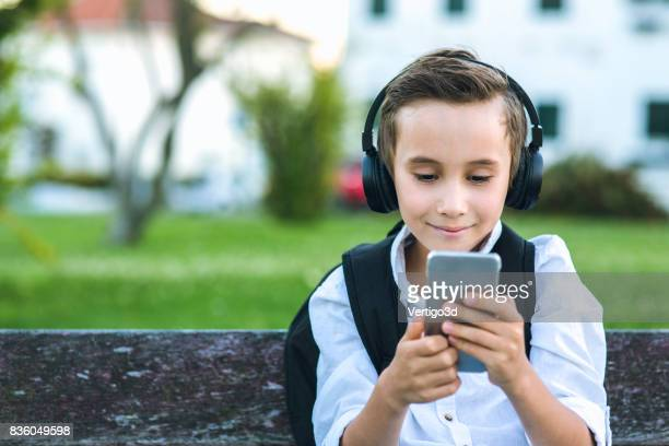 Elementary schoolboy use smartphone