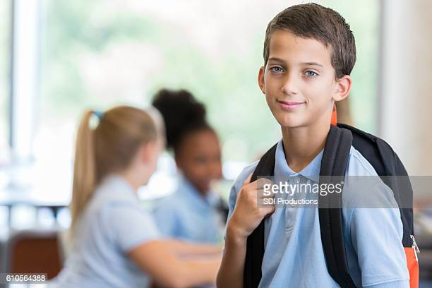 Elementary schoolboy waits for class to start