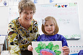 Elementary Student and Teacher Showing Painting