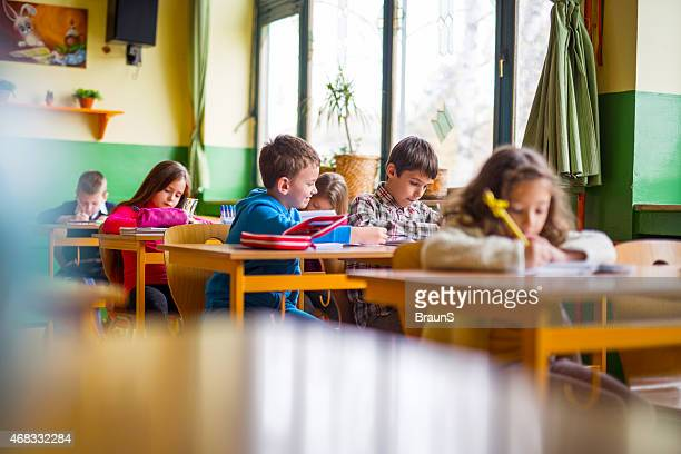 Elementary student trying to cheat in the classroom.