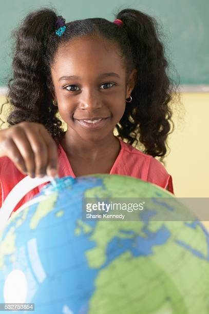 Elementary Student with Globe