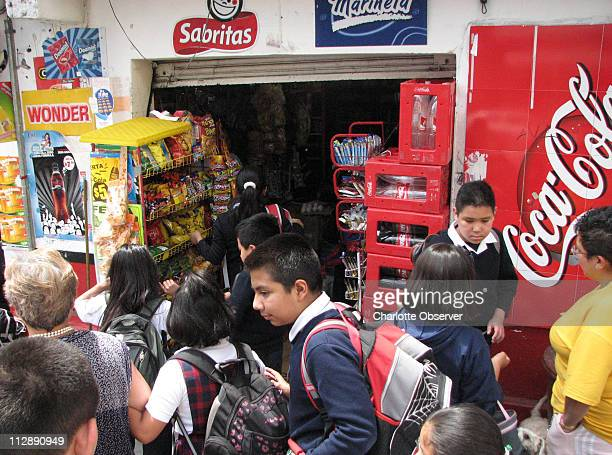 Elementary students in Mexico City line up outside a small convenience store to purchase soft drinks and potato chips Mexico is now the second...