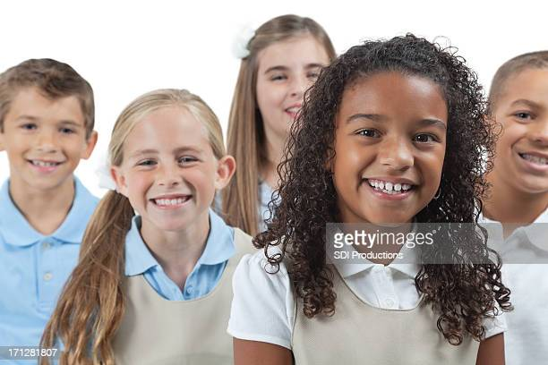 Elementary students in school uniforms, on  white background