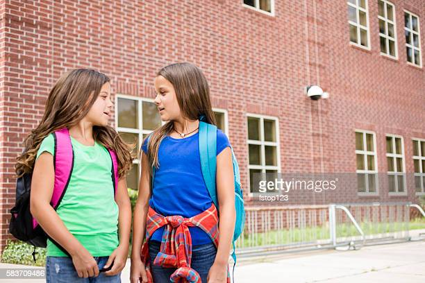 Elementary-age children on school campus going back to school.