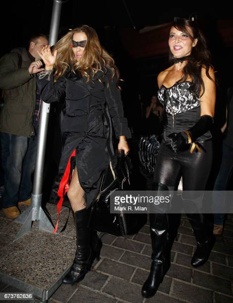 Elen Rives and Lizzie Cundy depart Caprice Bourret's 40th birthday and Halloween party at the Cuckoo Club on October 27 2011 in London England