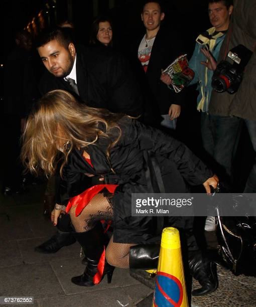 Elen Rives falls as she departs Caprice Bourret's 40th birthday and Halloween party at the Cuckoo Club on October 27 2011 in London England