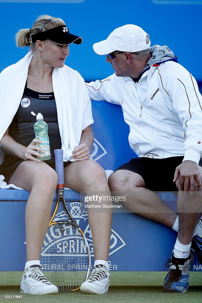 Elena Baltacha of Great Britain confers with her coach Nino Severino while playing Na Li of China during the AEGON International at Devonshire Park on June 15, 2010 in Eastbourne, England.