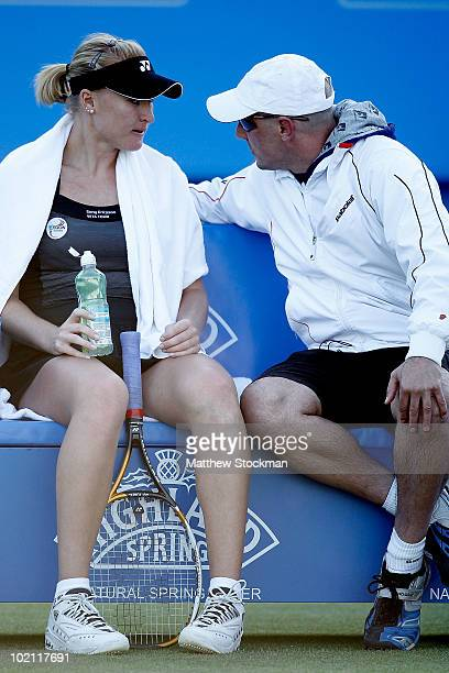 Elena Baltacha of Great Britain confers with her coach Nino Severino while playing Na Li of China during the AEGON International at Devonshire Park...