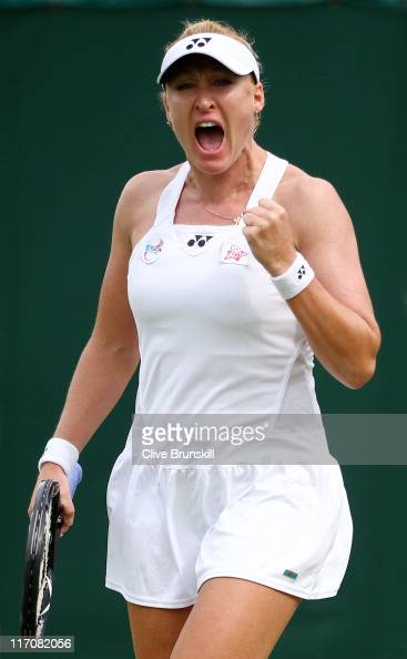 Elena Baltacha of Great Britain reacts to a play during her first round match against Mona Barthel of Germany on Day Two of the Wimbledon Lawn Tennis...
