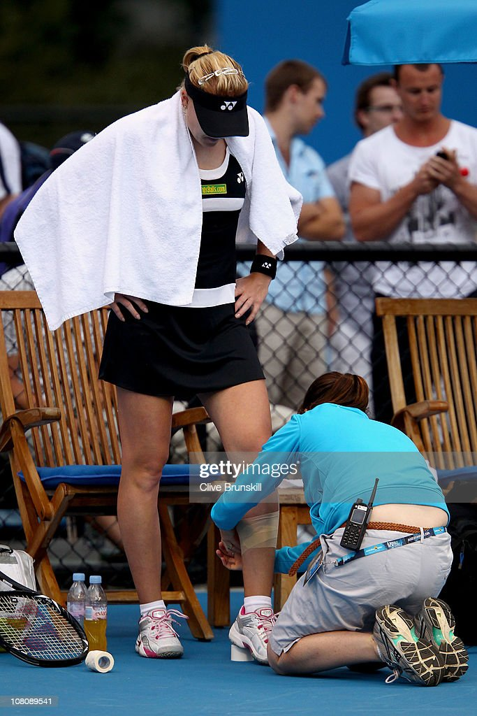 Elena Baltacha of Great Britain receives treatment in her first round match against Jamie Hampton of the United States of America during day one of the 2011 Australian Open at Melbourne Park on January 17, 2011 in Melbourne, Australia.