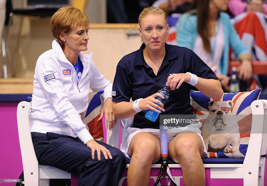 Elena Baltacha of Great Britain speaks to GB captain Judy Murray in her rubber against Johanna Larsson of Sweden during day one of the Fed Cup World Group Two Play-Offs between Sweden and Great Britain at Borashallen on April 21, 2012 in Boras, Sweden.