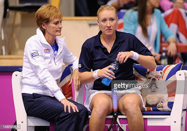 Elena Baltacha of Great Britain speaks to GB captain Judy Murray in her rubber against Johanna Larsson of Sweden during day one of the Fed Cup World...