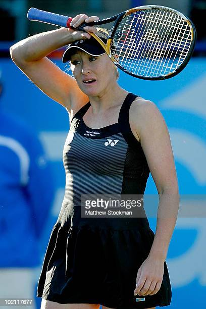 Elena Baltacha of Great Britain wipes her forehead between points against Na Li of China during the AEGON International at Devonshire Park on June 15...
