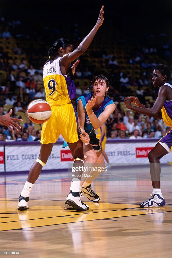 Elena Baranova #28 of the Utah Starzz passes the ball against Lisa Leslie #9 of the Los Angeles Sparks at Staples Center circa 1998 in Los Angeles, CA.