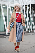 Elena Braghieri poses wearing a Max Mara coat Gucci bag Pinko skirt and Viavela14 shoes on January 17 2015 in Milan Italy
