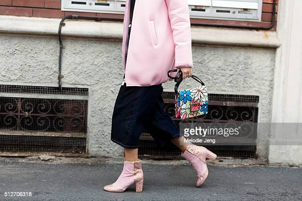 Elena Braghieri wears a pink Pinko jacket cropped flared Pink jeans a Roger Vivier purse and pink Polly Plume boots outside the Antonio Marras show...